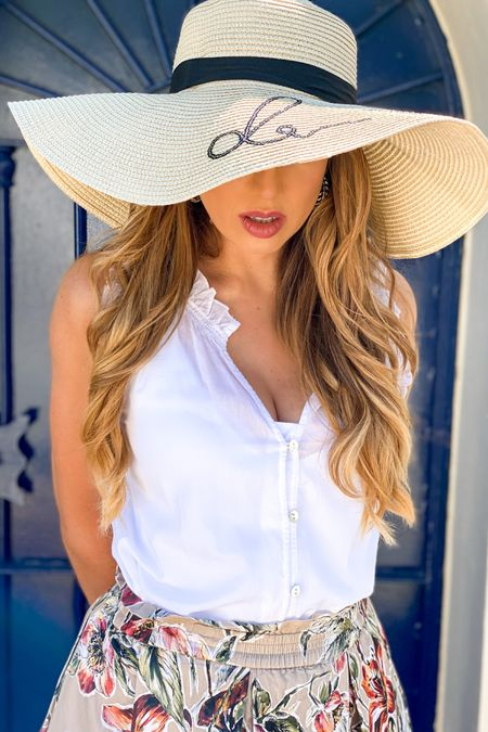 """Time to wear a hat! This """"Do not disturb"""" summer hat is just amazing. Ideal to instantly feel on vacation. You can find it at RivieraCoco.com.  Today's outfit is fresh, floral and with natural materials.  You can shop my look at the @liketoknow.it  app http://liketk.it/2Trw0  ..... I am wearing today a floral midi high waist cotton skirt, with a fresh cotton boutonnière top with feminine ruffles. As I love comfort I used my brown leather wedges.  I completed the look with gold leaf earrings, a @danielwellington watch and a very nice and colorful bag I got from Florence, Italy.  This outfit is ideal for a day at the French Riviera or a chic summer destination.  .... Keep posted to discover my upcoming blog """"10+ French Style Summer Outfits I Love"""" Visit 👉🏼 RivieraCoco.com Follow me on Pinterest @RivieraCoco we have almost 10+ MILLION ladies visiting my profile every month, searching for summer inspiration and woman empowerment.  .....  Download the LIKEtoKNOW.it shopping app to shop this pic via screenshot.   #liketkit #rStheCon #LTKshoecrush   @liketoknow.it.europe @liketoknow.it.home  #marbella #marbellalifestyle #floraloutfit #donotdisturb #frenchstyle #frenchriviera #RivieraCoco"""