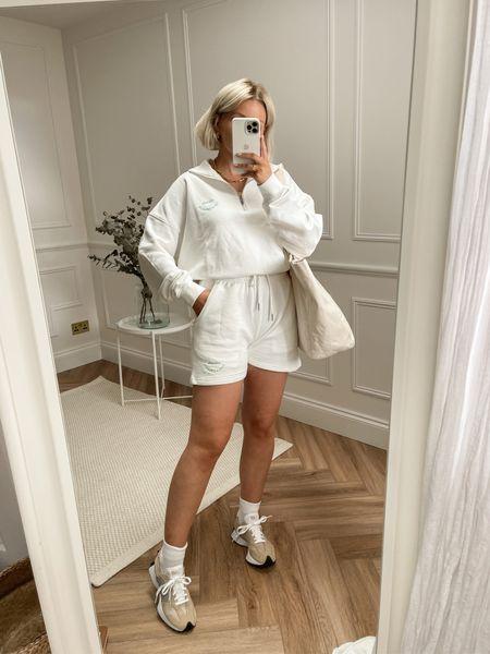 White sweatshirt shorts and half zip sweatshirt.