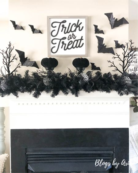 My Halloween mantle from last year. Black garland black pumpkins and black bats. Halloween decor ideas   #LTKhome #LTKSeasonal #LTKHoliday