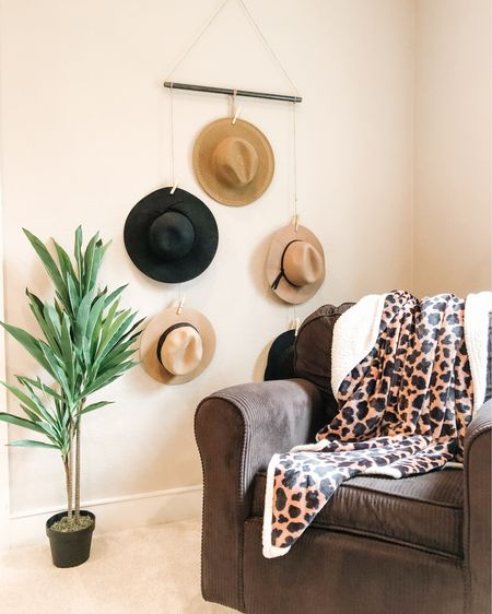My corner! This is my sanctuary, the place where I take a minute (or 20) to myself. This cozy rocker was one we used when the boys were babies and my leopard fleece blanket is something I can no longer live without. We built this hat hanger for all of my panama hats out of industrial pipes and today I added this artificial plant to add life (which is kind of ironic). http://liketk.it/2Nxix #liketkit @liketoknow.it #LTKhome #LTKsalealert #StayHomeWithLTK Follow me on the LIKEtoKNOW.it shopping app to get the product details for this look and others