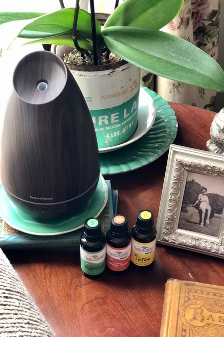 I use this diffuser and l these three essential oils together in the mornings, as a wake-up blend! I love that they're all organic, so I don't have to worry about breathing any toxins. These three scents might sound like they don't go together, but I love the scent of them in the morning! Almost reminds me of walking into a boutique hotel or something! I start my coffee, turn on the diffuser and settle in for my quiet time with my Bible, right next to this spot! http://liketk.it/3csMy #liketkit @liketoknow.it #LTKhome #LTKunder50 #diffuser #essentialoils #wakeupblend #mornings #quiettime