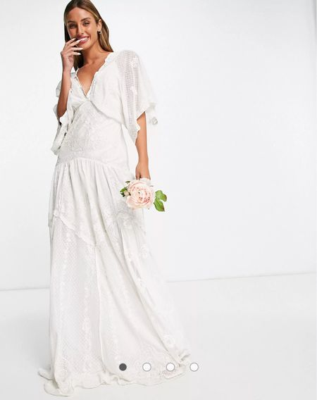 Looking for a whimsical wedding dress on a budget? This dress is perfect for a boho bride! Plus get it tailored and it will fit like a glove   #LTKwedding #LTKbump #LTKstyletip