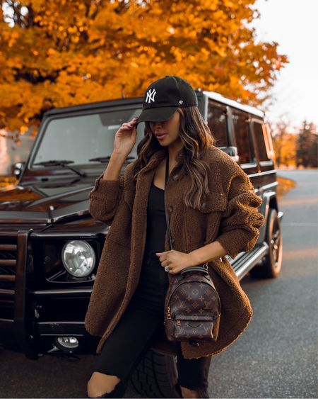 Fall cozy outfit ideas Good American shearling jacket wearing a 00/0 Louis Vuitton Palm Springs Mini Backpack   #LTKstyletip #LTKitbag #LTKSeasonal
