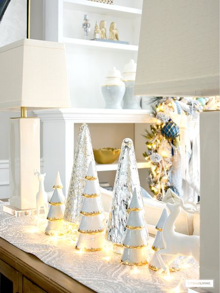 Christmas decor styled with fairy lights, reindeer and glittery trees! My LoHome trees are some of my favorite pieces!  #LTKHoliday #LTKstyletip #LTKunder100