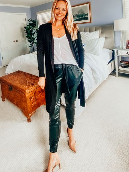 Open front black cardigan, white racer back tank, faux leather joggers and nude heels. Swap the heels for sneakers to wear this for running errands. Wear for  date night or casual cocktails. Size up in the joggers. Size down in the tank. Cardigan fits TTS.