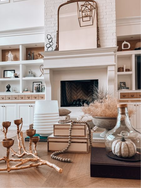 Coffee table style with organic , neutral, accessories. Branch candle holder, dried stems, white wood decor boxes , pumpkins, decor beads. Fall vibes & home decor . Living room style   #LTKSeasonal #LTKhome