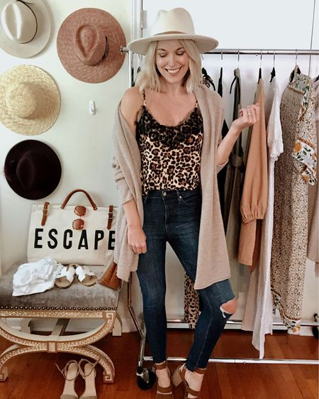 Leopard cami only $17 🐆 Runs TTS, straps are adjustable. Beige cardigan sweater High-waisted ripped skinny jeans  Heeled suede sandals White rancher hat Chanel makeup   http://liketk.it/2Ec3j @liketoknow.it #liketkit #LTKunder100 #LTKstyletip #LTKtravel Amazon, fall, casual