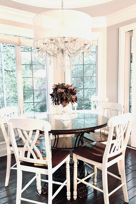 Everyday I look forward to eating at this table. The bright colors, enormous windows, and sparkling dome chandelier always hits the spot. Oh and the food is nice too!   #LTKfamily #LTKhome #LTKstyletip