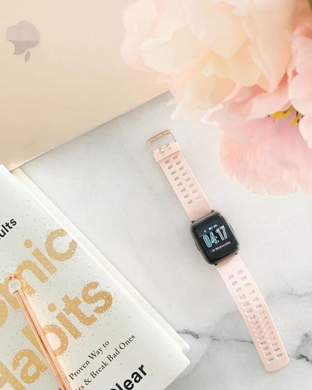 Loving my Amazon Pink Fit @liketoknow.it.home Smart Watch! It's has so many great features such as tracking steps, timer, sms notifications & more. Working away on my Rose Gold MacBook & reading Atomic Habits by James Clear when I need a little break. http://liketk.it/2W3Et #liketkit @liketoknow.it #LTKhome #LTKunder50 #LTKfit