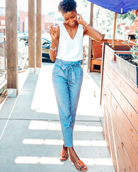 Denim Joggers with a bow | white v neck top | crown vintage sandals | summer sandals | animal print sandals | denim pants | summer looks | summer outfit | casual outfit | casual summer outfit | faux leather bag | chloe bag | curly hair | Coily hair | day time outfit http://liketk.it/2Qnsa #liketkit @liketoknow.it