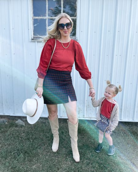 The girl insists that her purse has to be worn around the neck 😂 Our first trip to the pumpkin patch did not disappoint!! 🎃 This girl didn't want to stop for a pic.. she was ready to RUN through the rows of pumpkins! 🍁🍂 But had to share our outfits because I love a good coordinating #mommyandme moment ❤️  My eyelet top + plaid skirt are both 50% OFF!! 🙌🏼 & Breckyn's outfit + boots are from Walmart 😍   If you're in the KC area… I highly recommend #pumpkinsetc 🥰 It's free to visit, they have the cutest set up for kids & the pumpkins are super affordable!   SHOP our outfits •••••   #LTKunder50 #LTKsalealert #LTKfamily
