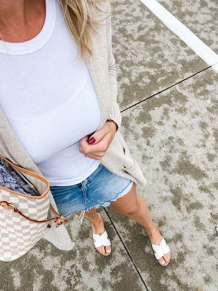 A great lightweight sweater is the perfect way to lengthen your summer wardrobe but stay comfortable when there's a chill in the air! I linked a few inexpensive options as well as direct links to the rest of the outfit.   #fall #transitional #denim #basics #ootd #outfit #momlife #skirt #duster #sweater #longsweater #neutrals #tanktop   #LTKSeasonal #LTKstyletip #LTKunder50