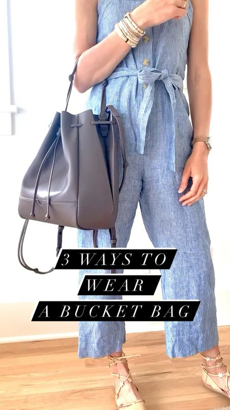 3 ways to style my new 100% vegan leather @vonHolzhausen bucket bag! This gorgeous bag is made from 100% vegan leather, aka Technik-Leather, made of recycled plastic, but looks just like the real deal. It's also stain and scratch-resistant which is every mom's dream!  You can wear this bucket bag 3 different ways—shoulder bag, handheld or as a backpack, which means it's going to get used a LOT! Which way would you wear it? #ad #vonholzhausen  #LTKstyletip #LTKitbag