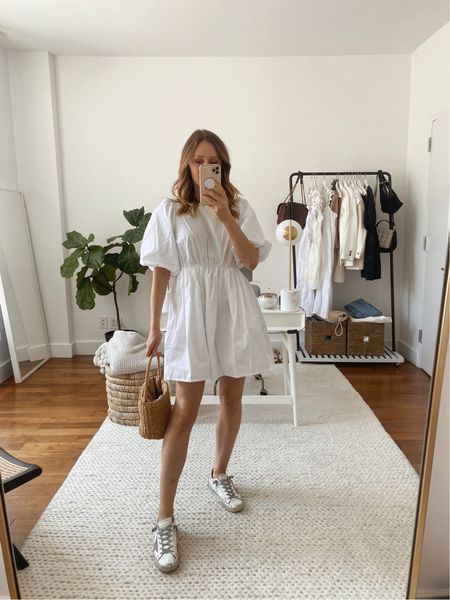 Summer outfit idea! White puff sleeve mini dress with white golden goose sneakers and a straw bucket bag. Dress runs true to size.  #LTKSeasonal #LTKstyletip #LTKunder100