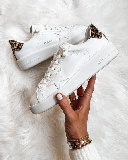 The most comfortable pair of golden goose sneakers are the purestars! Love the pop of leopard too #goldengoosesneakers #goldengoose #sneakers #whitesneakers http://liketk.it/3ihgi #liketkit @liketoknow.it #LTKshoecrush #LTKstyletip