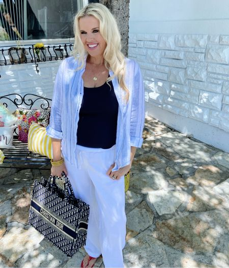 """""""When all else fails, take a vacation."""" —Betty Williams . Linen is Great traveling, it's easy to wear, breathable, looks chic and is comfortable!  -I adore white linen pants ( these are under $40) and @grayson button up shirts are so easy to style. Wear open like shown, throw over a swim suit or knot at the waits over a tee shirt dress❤️ I like to travel with a large bag and easy to wear sandals ❤️ . . .   #LTKtravel #LTKstyletip"""