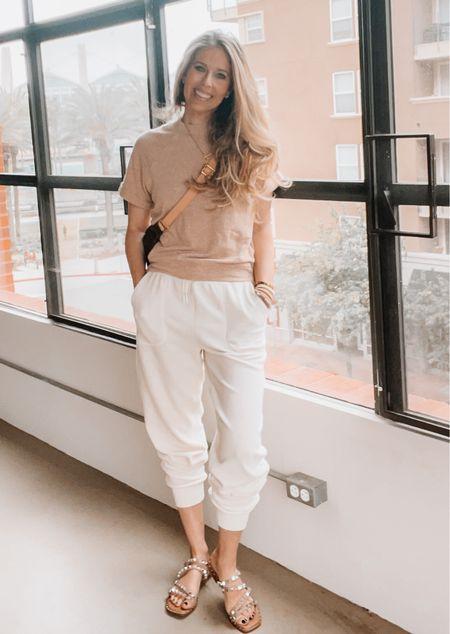 Travel outfit, summer outfit, sandals, short sleeve sweatshirt, white sweats, gold jewelry, Louis Vuitton   #LTKSeasonal #LTKtravel #LTKshoecrush
