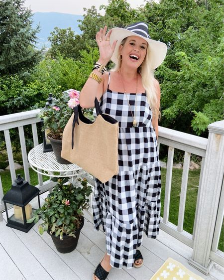 Styling Buffalo check for Summer✔️ This fun check is so fun to style for Summer, finding this buffalo check in a dress verses a top really kicks up the Summer vibe. (buffalo check often leans towards fall flannel button ups and a  Winter feel.  I love the bold check and pairing it with a sun hat by @dressbarn, a Great Straw bag and this seasons quilted sandals Give be All the Summer Vacation feels.🖤🖤🌴  . . . Shop this fun look and some other Cute Checked style dresses MOST under $20👇🏻👇🏻👇🏻 .  Shop my daily looks by following me on the LIKEtoKNOW.it shopping app Download the LIKEtoKNOW.it shopping app to shop this pic via screenshot  http://liketk.it/3jJHM #liketkit @liketoknow.it #LTKsalealert #LTKtravel #LTKstyletip  . .