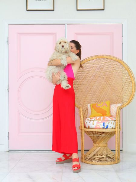 While red, white & blue is a classic combo I love, my favorite combo with red is pink! So I tossed on this pink & red jumpsuit with my new fave red Brooklyn Wedge @crocs from @dsw. Shop them in my Stories or via LIKEtoKNOW.it here at this link:   http://liketk.it/3iM7M   Odee's a fan too because they match her red cosmopolitan martini that she always brings me at 5 o'clock. No joke -- swipe to see! She's such a Palm Springs pooch.   I love them because they're cute AND comfy, which makes chasing her around easier. Dog mom life, am I right?   #MyDSW #influencer #crocs  #liketkit @liketoknow.it  #flatforms #comfyshoes #LTKshoecrush #LTKunder100 #LTKstyletip
