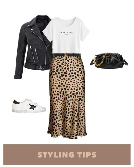 a faux leather Moto jacket paired with a satin leopard midi skirt , graphic tee , croissant pouch bag, and white sneakers makes a trendy going out outfit. Shop my daily looks and finds by following me on the LIKEtoKNOW.it shopping app I http://liketk.it/3hXMq #liketkit @liketoknow.it  l #LTKcurves #LTKsalealert #LTKstyletip #LTKtravel #LTKunder50 #LTKshoecrush #LTKitbag #LTKunder100 # #LTKSeasonal Amazing fashion   amazon finds   leather jacket outfit   faux leather jacket outfit   summer fashion    date night   midi skirt outfit   satin midi skirt   bags on sale   bags under 100   bags under 50   Abercrombie & Fitch   sneakers for women   graphic tee outfit   graphic tee and skirt   Moto jacket