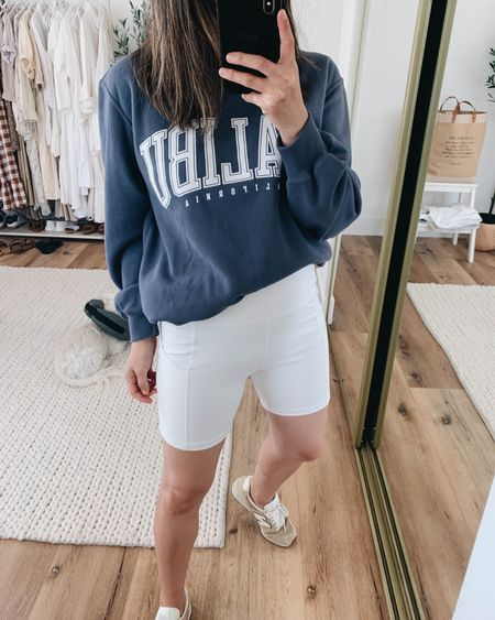 Graphic sweatshirt. Biker shorts. Affordable graphic sweatshirt.   Sweatshirt- A&F xs Shorts- Amazon small Sneakers- New Balance 6  http://liketk.it/3iCCC @liketoknow.it #liketkit #LTKunder100 #LTKshoecrush