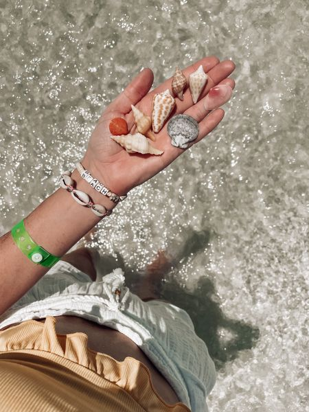A 6.5 morning beach walk [aka a hike 🥵] in 92° heat was intense, exhausting, fun AF and slightly dehydrating.   But nothing beats a morning spent hunched over, ass in the air, looking for some shells 😏🙃 #ifyouknowyouknow #sanibelstoop  We saw some sea turtle nests, a small sting ray, some horrifying crab/creature that was way too fast for comfort, and made a handful of new shelling buddies! (Ruth from Ft Lauderdale, this one'd for you!!!)   My jaw literally hurts from smiling today! 😬 truly in my happy place with my favorite Dave!!   Where is your happy place?    #LTKswim #LTKtravel