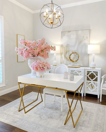 White and gold home office, glam office decor, mirrored cabinet, white sideboard, pink cherry blossoms, pink peonies, white desk, white office chair, white dining chair, grandmillennial, Father's Day gift ideas @liketoknow.it #liketkit http://liketk.it/3hXWZ #LTKhome #LTKsalealert #LTKunder50