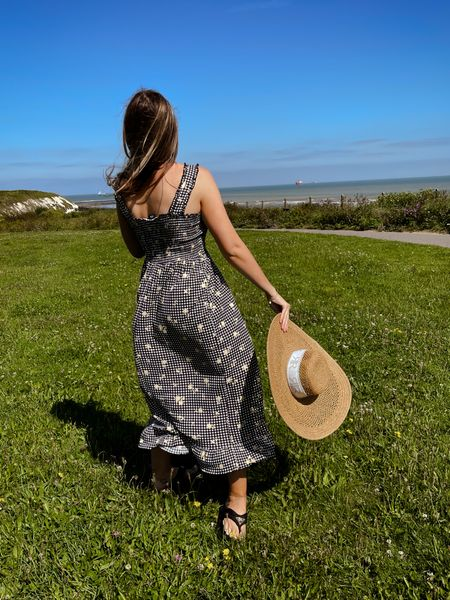 Beautiful gingham midi summer dress styled with oversized straw hat and black thick sole flip flops    #LTKeurope #LTKunder50 #LTKstyletip