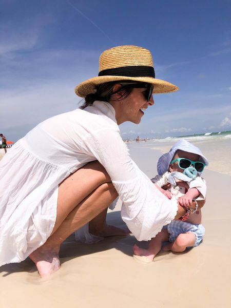 Weldon's first dip in the ocean! Little beach baby. 🏖 It took us a few days to find our groove, but we had the best day at the beach today! Weldon loved it! 🐠 ☀️ 🌴   My hat, sunnies, and cover up + Weldon's gear are all shoppable through the link in my bio and in the LTK app!   #LTKswim #LTKbaby #LTKtravel