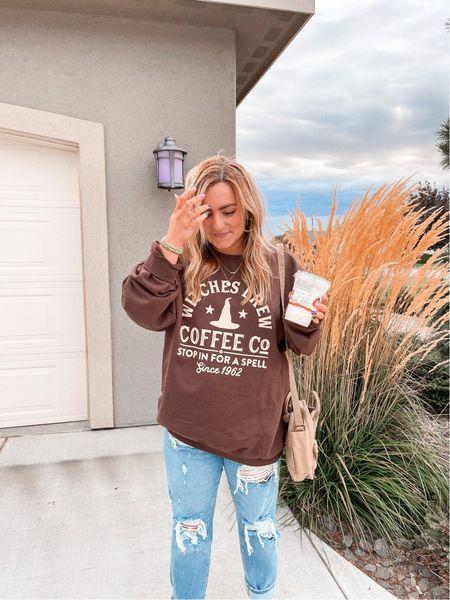 Fall sweatshirt Halloween graphic tee Oversized crew neck Witch's brew coffee Distressed denim Crossbody fjallraven bag   #LTKSeasonal #LTKstyletip #LTKunder50