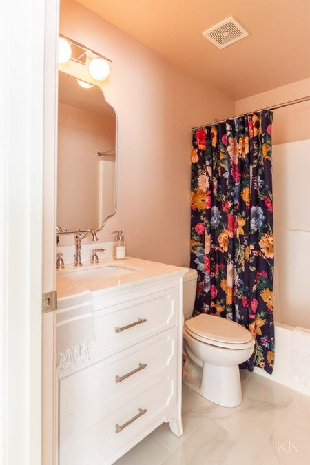 Shop all the deets from my new pink bathroom. Home decor powder room decor bathroom decor chrome faucet floral shower curtain foaming soap dispenser farrow& ball setting plaster sconce nickel mirror  #LTKunder50 #LTKhome #LTKstyletip