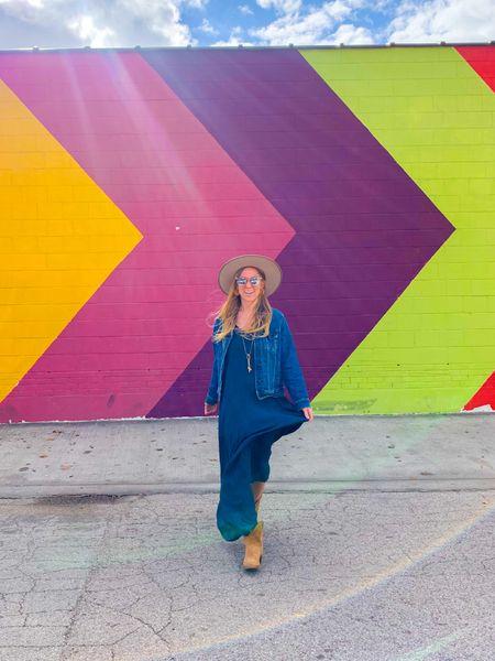 Navy blue maxi dress, chicwish white cream chunky knit sweater, tan fedora hat, tan ankle cowboy boots, brown booties, blue denim jacket   #LTKsalealert #LTKunder50 #LTKNewYear