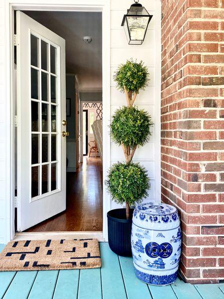 Back door decor, front door styling, faux boxwood topiary, blue and white garden stool, doormat, outdoor lantern lighting   #LTKunder100 #LTKhome #LTKSeasonal