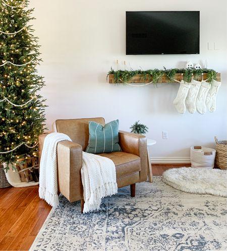 Loving the garland we got for mantle. Living room Christmas decor inspo.   #LTKfamily #LTKhome