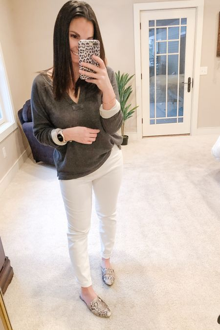 I was talking with some people today about how perfect white jeans are just so hard to find. I truly don't believe that they exists. Either the fit isn't right or they're too transparent. This pair from @abercrombie might be as close as it gets for me.  Also this light sweater screams soring transition and it's so soft! There are a few color options and I know that the yellow striped option is currently $20! True to size.   http://liketk.it/3a7gT #liketkit @liketoknow.it   Follow me on the LIKEtoKNOW.it shopping app to get the product details for this look and others