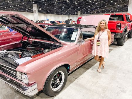 Just posing next to a cool car that matches my dress!  This past weekend we took a trip to #orlando and attended the @mecum-auction show.   So many cool cars.  Sometimes it's ok to humor your husband.  I love seeing him in his element and it was actually fun.  No cars were purchased but I did find two dream cars.  Stay tuned because if I get my way (wink) I'll be up grading my current vehicle!!  My dress color is no longer available but two other colors are linked.   #LTKsalealert