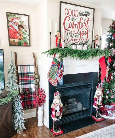 Tartan plaid Christmas decor tartan plaid throw blankets on blanket ladder nutcrackers dressed in tartan plaid suits real touch garland on fireplace mantle holiday decor Christmas living room   #LTKHoliday #LTKSeasonal #LTKhome