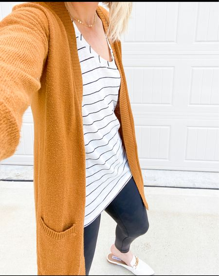 Cardigans make a great layering piece this time of year. If you're petite, don't forget to check the girls section for sizes   Cardigan shown is Girls' sie XXL (16) from previous year but linked similar from same store.  Spanx leggings are small petite  Tee is size small -true to size  Mules are sold out but linked similar style to achieve same look.       Cardigans , sweater , cardigan sweater, sweater weather , fall tradition outfit , mules , faux leather leggings , amazon fashion , amazon finds , old navy , tee , fall fashion , women's jewelry , nordstrom style , leggings outfit , teacher outfit , #ltkshoecrush , #ltkunder50 #ltkstyletip  #LTKunder100 #LTKworkwear #LTKSeasonal