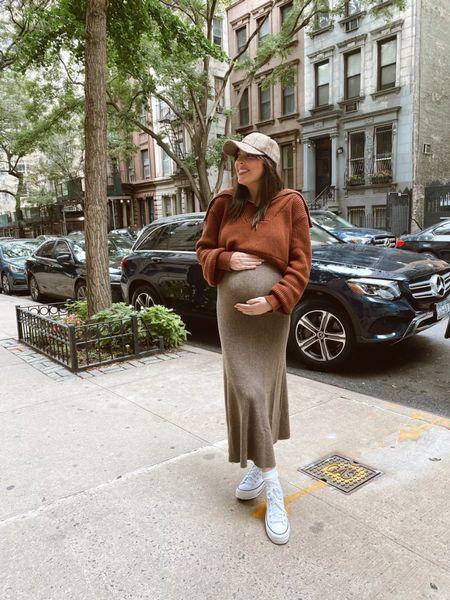 Fall maternity outfit wearing a cashmere skirt, zip up sweater and high top converse     #LTKbump #LTKstyletip #LTKshoecrush