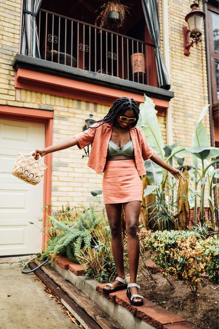 Rust top and skirt set layered with an olive two piece swimsuit for versatility.   #LTKunder100 #LTKtravel #LTKunder50