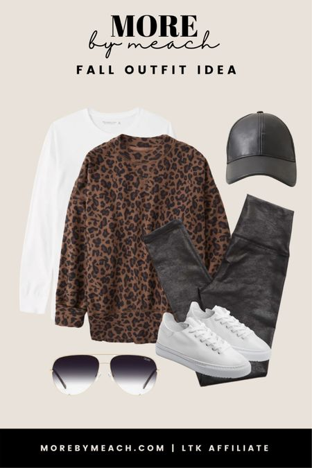 Loving this leopard print sweatshirt and faux leather leggings combo! 🤍 Such a cute casual fall outfit idea that anyone can pull off. || faux leather hat, white sneakers, Quay sunglasses, comfy casual, neutral outfit, travel outfit   #LTKSale #LTKSeasonal #LTKtravel