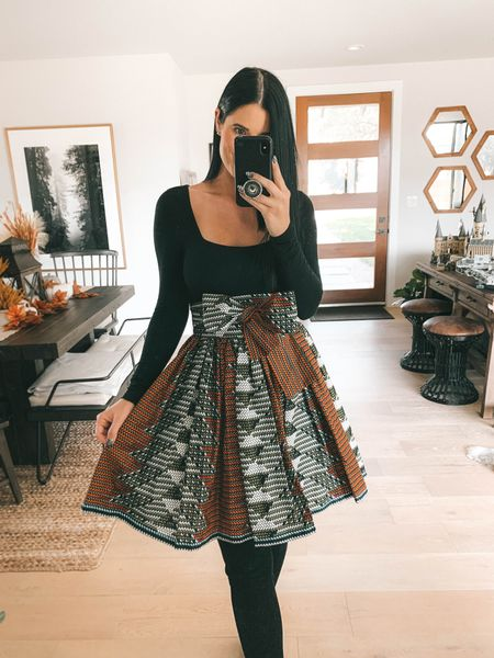 This skirt is from Sika and not linkable! I linked a few black bodysuit options! This exact one is almost sold out. I'm wearing a medium. My otk boots over the knee boots are 40% off with code ASHLEYH40! Go up to your next full size.   #LTKshoecrush #LTKstyletip #LTKsalealert