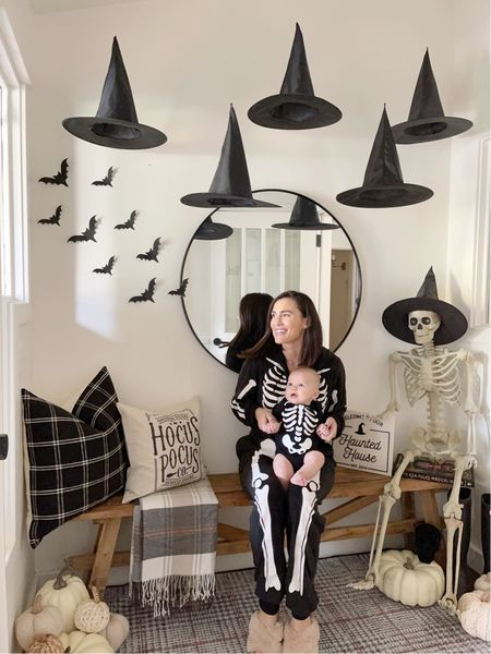 W E S T \ Waiting on witches with my 5 month old baby boo🧙🏻♀️👻   I can't believe we are already here!!🤯 Swipe right to see my little skelly babe💀 He's been all smiles, rolling, eating up a storm and now, sleeping in his own room👏🏻 West is getting SO big😭😭😭 It really does go by fasttttttt  Enjoying this time with him and I'm loving our first October/Halloween 🖤🖤🖤  Learn how-to hang witch hats on my REELS. It's V easy!! Shop our spooktacular entry and skeletons on the LTK app! Click the link in my bio🧙🏻♀️  #sbkliving #halloween #halloweendecor #entry #entryway   #LTKfamily #LTKhome #LTKSeasonal