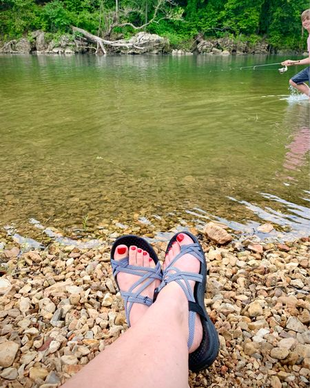 Loving these sandals for walking, wading, and wasting time....down by the river.🤣  We're camping this weekend. It's rained a little but the boys have still managed to catch some fish species they have never snagged before here in Oklahoma. Peep my teen about to wade right through my photo. Haha! They've soaked all their clothes and will be fishing naked soon: all other campers beware!😂  Shop by clicking the link in my profile or by following me in the LIKEtoKNOW.it app.    #LTKstyletip #LTKunder50 #LTKfamily