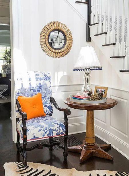 Front entry decor. Sunburst mirror, striped wallpaper Table lamp pillow chair blue and white   #LTKhome #LTKstyletip #LTKunder100