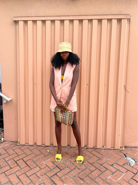 Last minute vacation outfit! Peach vest, peach shorts, yellow bucket hat and yellow padded mules.   #LTKSeasonal #LTKtravel #LTKunder50