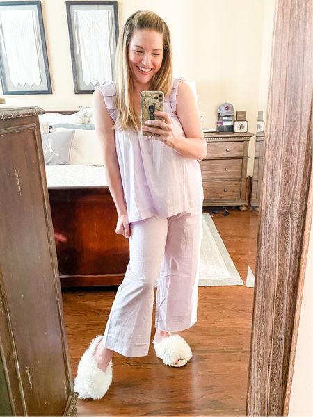 """Count me a """"yes"""" for loungewear! I don't know about you, but a transition in seasons has me looking at a transition in my closet. While I'm mentally ready for all that is fall, the Houston thermostat says different.   I'm living in my lavender + house shoes and not mad about it. My lounge set is still available in limited sizes and doesn't disappoint. Plus I've linked some slipper options for your toes!  My look is linked on #ShopLTK.   #LTKunder100 #LTKSeasonal #LTKstyletip"""