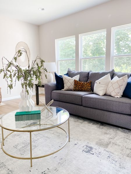 This gold and glass coffee table feels elegant next to the gray couch.  Coffee table, living room decor, sofa, gray couch, accent furniture, traditional decor  #LTKhome
