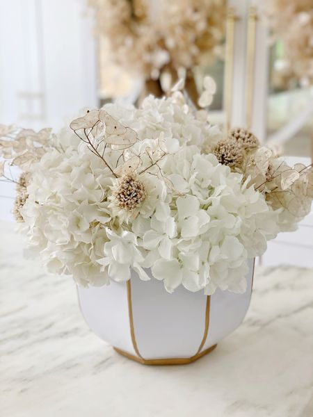 Simple fall arrangement with white hydrangea, thistle and lunaria. I used the white bamboo bowl but you could also use the cache pot.  I used 8 hydrangea, 2 thistle stems (cut up with green removed), and a bunch of dried lunaria.  #LTKSeasonal #LTKhome #LTKstyletip