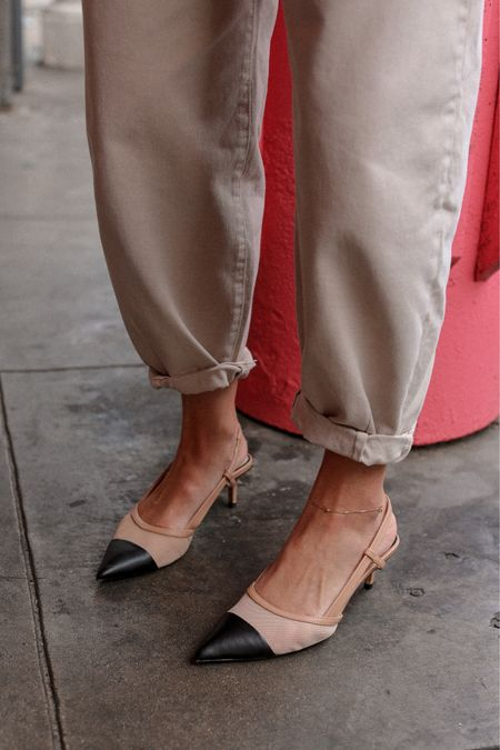 the Classic sling back kitty heel, and undone cuffed denim.